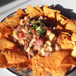 Mexican Gump Recipe - This recipe is fast and great for those nights that you don't want to spend a long time cooking.  If you love cheese...don't miss this one! You can use any type of noodles you have on hand. Serve with tortilla chips or crackers.