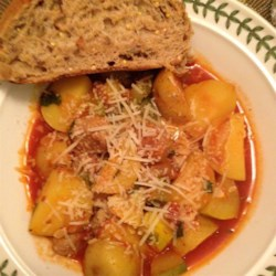 Summer Squash and Sausage Stew  Recipe - Summer squash, such as green and yellow zucchini and yellow crookneck squash, add flavor and heartiness to a delightful tomato-based stew flavored with Cajun Andouille sausage and served with a sprinkling of Parmesan cheese. Serve with a big slice of crusty bread to dip into the broth.