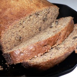 Whole Wheat Banana Nut Bread Recipe and Video - This is a very moist, honey-sweetened loaf with only nuts and a splash of vanilla to heighten the rich fruitiness.