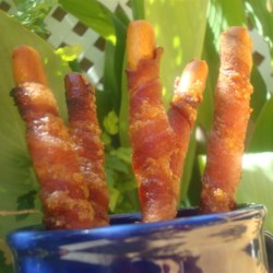 Candied Bacon Sticks Recipe - Bacon is wrapped around crispy breadsticks, sprinkled with brown sugar, and baked into candied bacon sticks for a fun appetizer everyone will love.