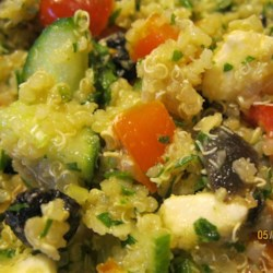 Veggie, Almond, and Raisin Quinoa Salad Recipe - Almond and raisin quinoa salad loaded with veggies and feta cheese is a hearty side dish or can be served as a main dish topped with chicken.