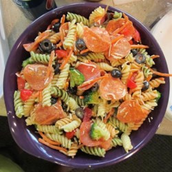 Simple Italian Pasta Salad Recipe - Delight your guests with this crowd-pleasing and easy Italian pasta salad featuring veggies, pepperoni, and black olives.