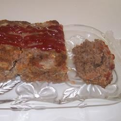 Best Ever Meatloaf I Recipe - Rolled oats, tomato juice, and onions combine with lean ground beef for an easily prepared meatloaf. It bakes in one hour.