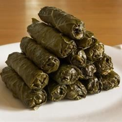 My Own Famous Stuffed Grape Leaves Recipe - These are grape leaves, stuffed with a tantalizing mixture of rice, fresh dill, mint and lemon. 'Yum' is the only one word to describe these. These can either be a main dish or an appetizer, depending on your appetite. Serve with good crusty bread and a Greek salad, if desired.