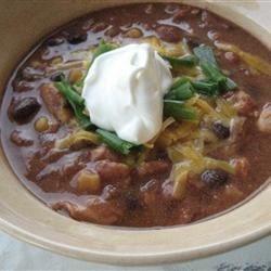 Chicken and Corn Chili Recipe - Use a slow cooker to make this chili with chicken, pinto beans, and corn, flavored with salsa, cumin, and chili powder.