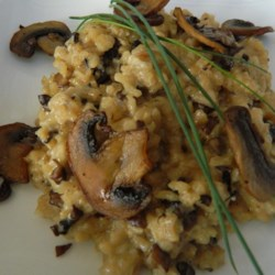 Chef John's Baked Mushroom Risotto Recipe and Video - Take the guesswork out of risotto with this recipe where the rice is started on the stove, baked halfway through the process, then finished with cheese and chives on the stove.