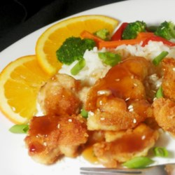 Asian Orange Chicken Recipe - Enjoy delicious citrus chicken marinated in lemon and orange juice with brown sugar, vinegar, soy sauce, garlic, and ginger. It's terrific served with rice.