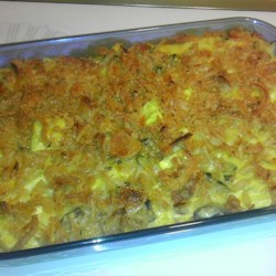 Mom's Squash Casserole Recipe - Yellow squash baked with onion, mushroom soup and Cheddar cheese, with a crouton crust.