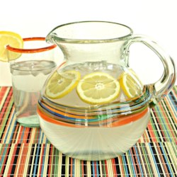 Good Water Recipe - This delicious 'good' water, made with water, sugar, and lemon extract, is a great punch for your next big gathering.