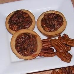 Tiny Pecan Tarts Recipe - These are so easy and melt in your mouth!  My brothers request these every year for the Holidays, as well as my family.