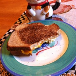 Campfire Breakfast Sandwich Recipe - An egg and cheese breakfast sandwich is toasted in the coals of a campfire with a Hobo Pie toaster.