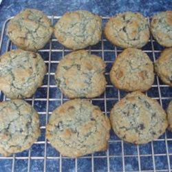 Blueberry Oatmeal Chocolate Chip Cookies Recipe - Everyone's favorite, chocolate chip cookies, get a delicious update with the addition of oats and blueberry jam to the dough.
