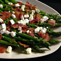 Roasted Asparagus with Bacon and Feta Cheese Recipe - Warm weather brings asparagus to season. This recipe roasts the seasonal favorite so it can be topped with year-round favorites bacon and feta cheese.
