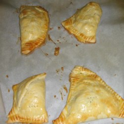 Squash and Kohlrabi Empanadas Recipe - Easy empanadas are made with store bought pie crust and filled with seasonal vegetables.