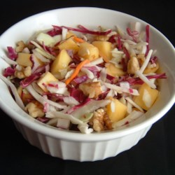 Tangy Mango Slaw Recipe - Here's a refreshing salad that you can feast on without fear. It's low-calorie and packed with disease-fighting antioxidants in the cabbage, onion, mango and walnuts.