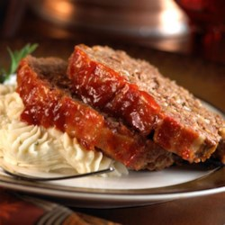 Blue Ribbon Meatloaf from Crosse & Blackwell Recipe - Zesty cocktail sauce in the ground beef blend and the mustard-brown sugar glaze lend rich flavor to this classic family favorite.
