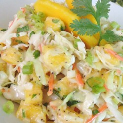 Mango Cilantro Slaw Recipe - This recipe calls for a unique twist on traditional cabbage coleslaw: mango. Sure to be a crowd-pleaser and it tastes great on fish tacos!