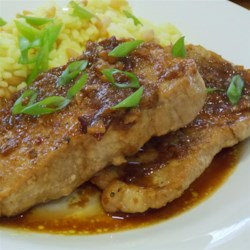 Pork with Plum Sauce Recipe - A sweet and savory plum sauce, flavored with ginger and cloves, highlights the flavor of pan-braised pork chops for an easy summertime dinner.