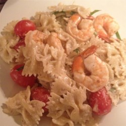 Creamy Tomato-Basil Pasta with Shrimp Recipe - You might want to hire a waiter to serve this one. With fresh tomatoes and chopped basil along with savory shrimp and pasta, it's that close to a seriously high-end entrée.