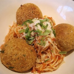 Faux Meat Balls Recipe - Seasoned bread crumbs are combined with eggs, Parmesan cheese, garlic and herbs, formed into balls, and either baked or fried.  Serve in place of meatballs with your favorite pasta dish.