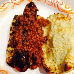 Kathy's Meat Hot Sauce Recipe - If you grew up with the tradition of eating meat hot sauce on your burgers and dogs, or you just want to start a new tradition of your own, try this spicy meat sauce recipe.