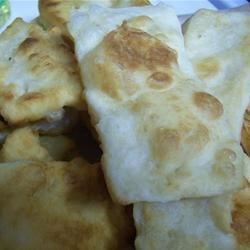 Sopapillas Recipe - This light and tender fry bread dessert hails from Mexico.  Roll in cinnamon sugar immediately after frying, or try drizzling with honey.