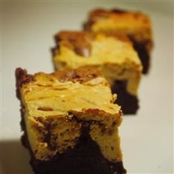 Peanut Butter Brownies II Recipe - These brownies bake up gooey, and are a BIG hit with my family and friends! Has been a family recipe for years.  I undercook them just a little, and cutting with a plastic knife works well.