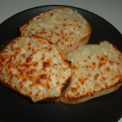Cheese Onion Garlic Bread Recipe - Plenty of garlic and melted Italian cheeses taste wonderful on pieces of sliced French bread.