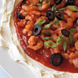 Layered Shrimp Dip Recipe - Olives not only make this creamy layered shrimp dip look pretty, they add a nice flavor twist to an otherwise straightforward party favorite. Crab may be substituted for shrimp.