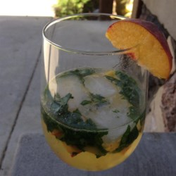 Peach-Basil White Sangria Recipe - Fresh peach and basil give a refreshing edge to this white sangria sweetened with agave nectar.