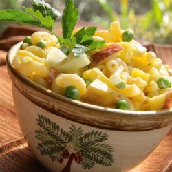 Cold Tropical Macaroni Salad Recipe - Apple, pineapple, peas, hard-cooked eggs and pasta in a creamy dressing.