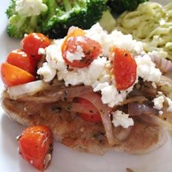 Pork Chops with Fresh Tomato, Onion, Garlic, and Feta Recipe - You will not be disappointed with this wonderful pork chop. It is tender, moist, and full of fresh flavors. I serve with garlic mashed potatoes and asparagus. It's a favorite in our household.