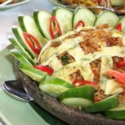 Indonesian Fried Rice Recipe - Vegetables and rice are wok-fried with sesame oil, chiles, and other seasonings in this flavorful side dish.
