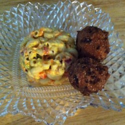 Mom's Cajun Hush Puppies Recipe - These spicy hush puppies are loaded with bell peppers and pimento peppers for a colorful and tasty treat. Serve alongside tartar sauce for a delicious appetizer.