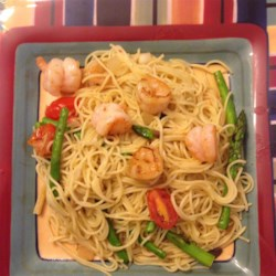Garlic Angel Hair Shrimp Recipe - This garlicky shrimp, pasta, and asparagus and tomatoes dish will please the entire family.