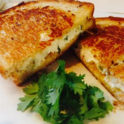 Jalapeno Popper Grilled Cheese Sandwich Recipe - A spicy jalapeno cream cheese spread, Colby-Monterey Jack cheese, and crunchy tortilla chips are sandwiched between buttery grilled ciabatta bread in this grown up version of the classic grilled cheese sandwich.