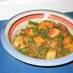 Pumpkin Curry with Lentils and Apples Recipe - East meets West in this inspired curry dish combining fresh pumpkin with lentils, carrots, potatoes, tomatoes, fresh spinach, and apples designed to delight vegetarians.