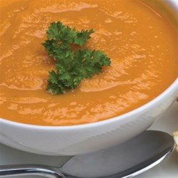 Curried Coconut-Carrot Soup Recipe - Roasted carrots and onions bring rich flavors to this coconut-carrot soup with ginger.
