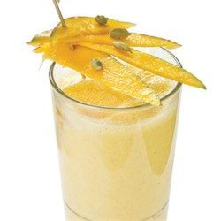 Mango- Coconut Smoothie Recipe - The taste of the tropics--coconut and mango--make a quick and refreshing smoothie.