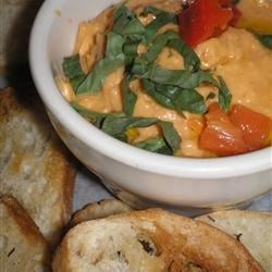 Italian Hummus Recipe - A different kind of hummus, featuring fresh basil and tomatoes - smooth, flavorful, and delicious.