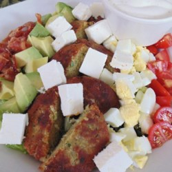 Falafel Cobb Salad Recipe - This falafel cobb salad made with avocado, feta cheese, eggs, and bacon is a Mediterranean-inspired version of the traditional American salad.