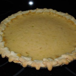 Zucchini Cream Pie Recipe - Cooked zucchini is pureed with evaporated milk, sugar, egg, flour, margarine and vanilla. This custard-like filling is poured into an unbaked pie shell, sprinkled with cinnamon and nutmeg, and baked until set.