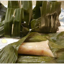 Thai Steamed Banana Cake Recipe - This is a denser version of the traditional banana cake and is very easy to make. You can either steam it in a square baking tin, in individual foil cups or do it the traditional way, in banana leaves.