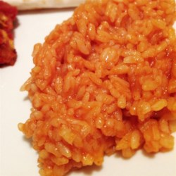 Easy Authentic Mexican Rice Recipe and Video - This Mexican rice is cooked with onion powder, garlic powder, and tomato sauce for an easy side dish finished in under half an hour.