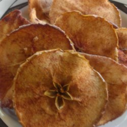 Baked Apple Chips Recipe - Simple to make and delicious to eat, these baked apple chips have the crunchy satisfaction of a potato chip without the guilt.