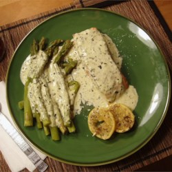 Salmon in Creamy Silk Sauce Recipe - Salmon cooked in parchment with lemon, rosemary and thyme, served with a silky cream sauce.  Great with steamed asparagus and parsley potatoes.