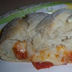 Pepperoni Stromboli Recipe - Bread dough is stuffed pepperoni and mozzarella cheese, and topped with a decorative braid.