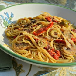 Emily's Mediterranean Pasta Recipe - A quick delicious vegetarian dinner recipe made with olives, mushrooms, and sun-dried tomatoes.