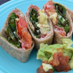 BLT Rollers Recipe - We've never met a BLT we didn't like, and our tortilla version is no exception. All the elements of the classic, rolled and cut into bite-size pieces to share with your peeps.
