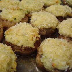 Savory Crab Stuffed Mushrooms Recipe - Mushrooms stuffed with a crabmeat and bread crumb mixture are topped with cheese and baked in a buttery wine sauce.